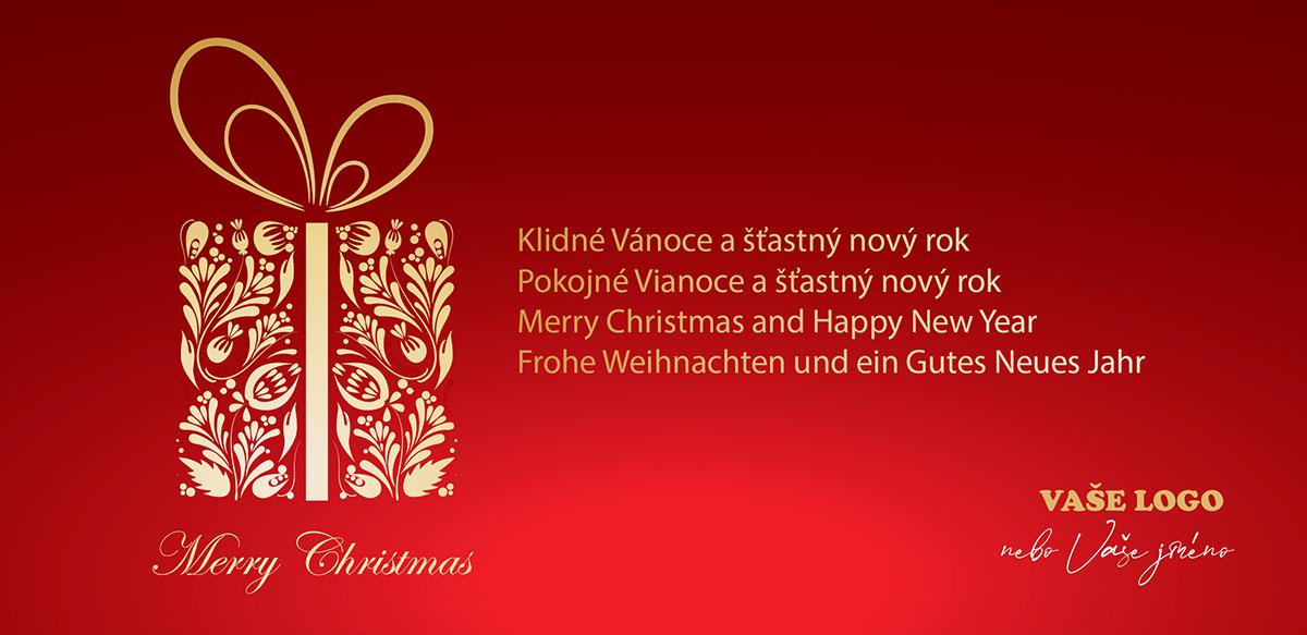 Vánoční přání se zlatým dárkem vyobrazeným z květinových ornamentů na červeném pozadí.