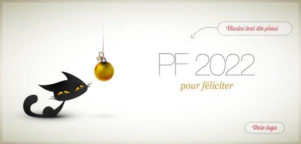 Vtipné vánoční přání s černou kočkou číhající na zlatou zavěšenou vánoční ozdobu.