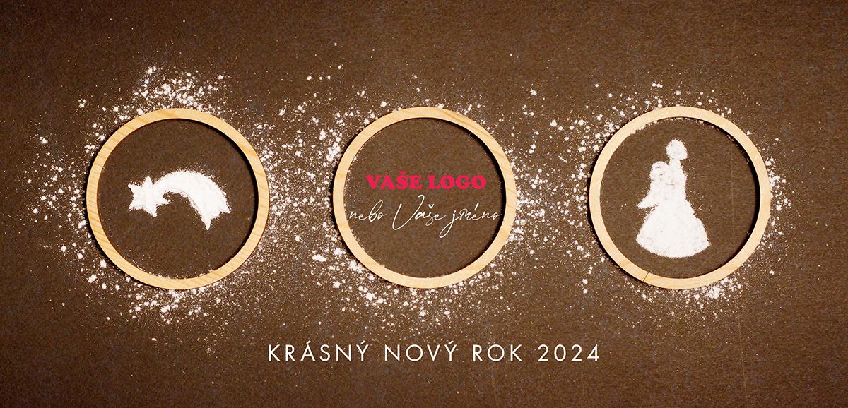 Nápadité firemní novoroční přání s cukrem vysypanými vánočními motivy na pozadí kakaového těsta.