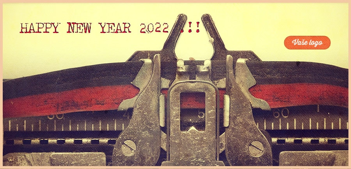 Retro firemní novoročenka s detailem na starý psací stroj a přání štěstí do nového roku.