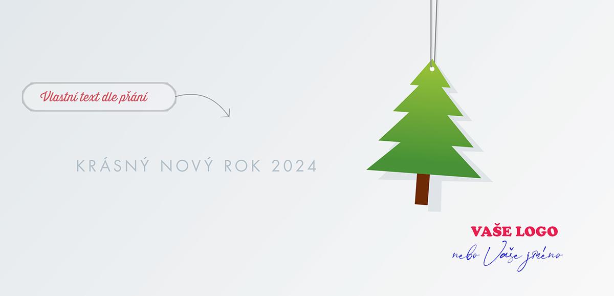 I obyčejné vánoční přání s přiznaně zavěšenou ozdobou stromku na bílém pozadí má kouzlo