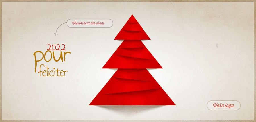 Kreativní vánoční přání poskládané z vystřihnutých červených trojúhelníků na pozadí přírodní barvy