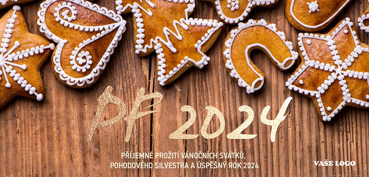 Nádherně vyzdobené vánoční perníčky na dřevěném pozadí zaručeně vyšperkují novoročenky.